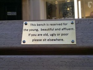 Bench-signs-in-Chester-UK-which-artists-claim-were-a-humorous-way-to-protest-at-plans-to-bring-in-Public-Space